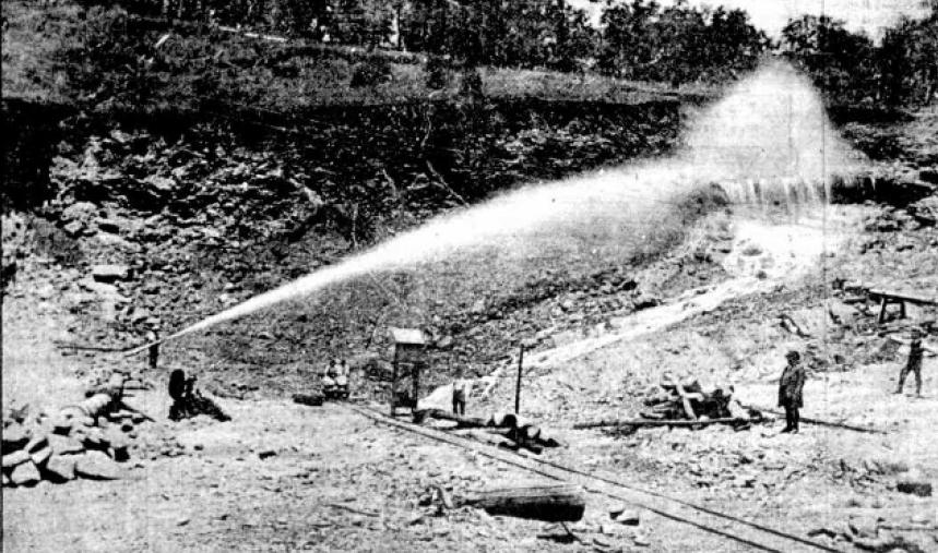 Historic photograph of pressure hose at Mount Sheba mine near Nundle NSW.
