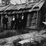 Workers outside hut at the Styx River about 1908.